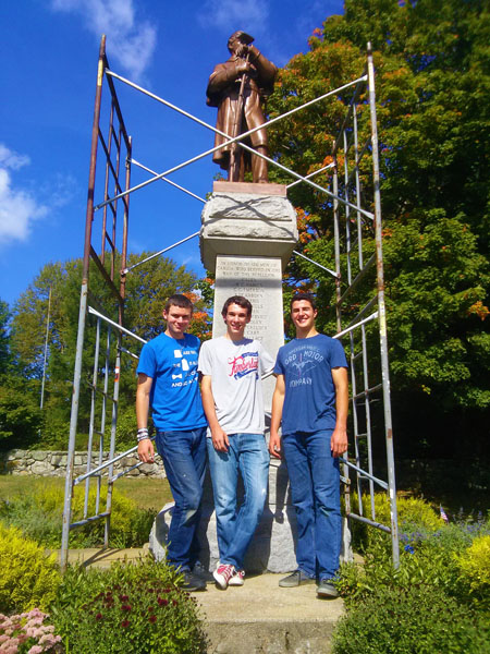 Left to right, Jesse Remington High School students Jacob Higgins of Hampton, Matt Clark of Loudon and Mason Burke of Barrington pose in front of the Candia Soldiers Monument, which the trio recently helped clean and wax