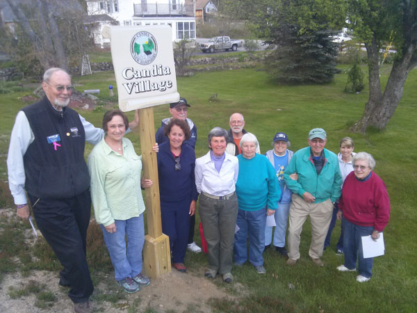 "Candia residents dedicate a new sign marking the area of town known as ""The Village."""